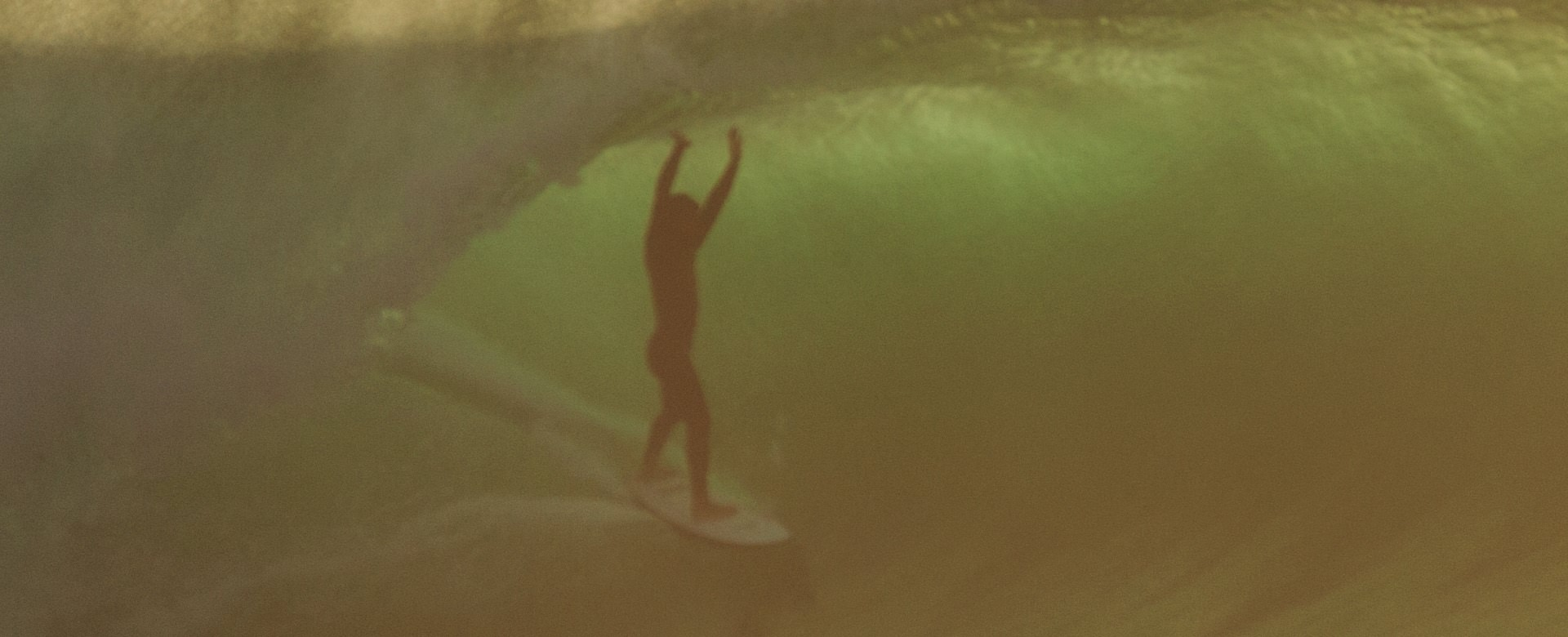 Riding the tube in Supertubos, Peniche